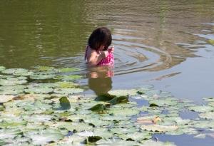 Balinese girl fishing using her skirt
