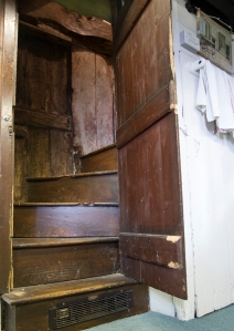 Stairs behind the door in the School House