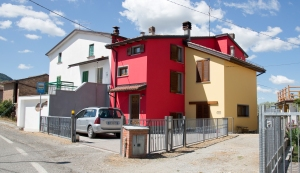 Red house in Italian village in the mountains
