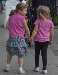 Girls strolling hand in hand