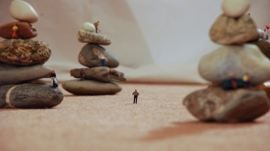 Tiny figures scale rocks