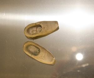 Tiny carved clogs