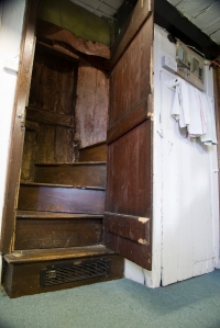 A cupboard full of stairs in the wooden annexe at the end of St. Nicholas Church